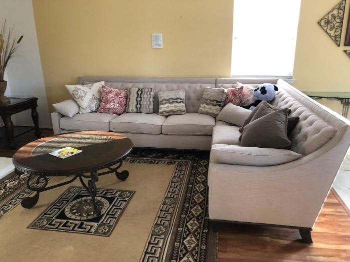 Two connecting sofas $1200. Round table $100