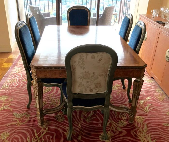 Burled Dining Table has total of 8 Chairs and 4 leaves