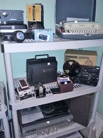 8mm projectors, vintage Polaroid, Kodak Instamatic M6 8mm movie camera, Brownie Hawkeye, projector screen
