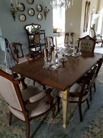 Dining table, chairs, room rug.