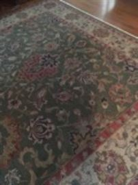 Area rug with greens and pinks