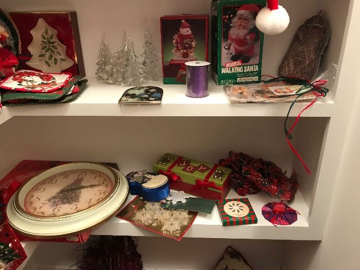 A Christmas tree clock along with other winter decorations