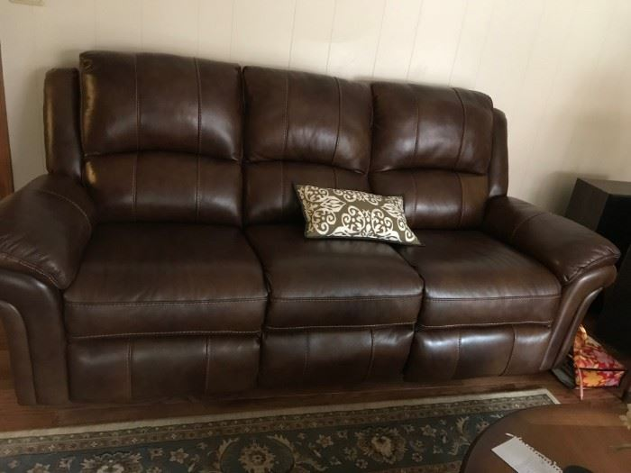 #1brown leather recliner sofa $400.00