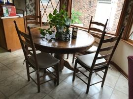 #8round as is pedistal dining table w 6 chair w ratan seat 47x30 $175.00