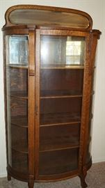 Curved curio cabinet