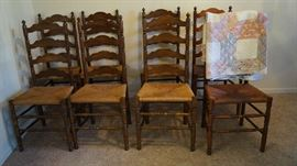 8 ladder back cane bottom chairs