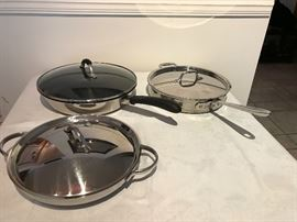 """Front pan:  Revere Proline Back left: Revere Excel 12"""" fry pan Back right:  All Clad fry pan"""