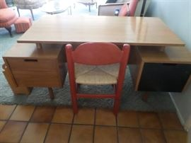 Mid-Century teak 2 sided desk with floating top,. Two drawers at left, one at right, backside has bookshelf.