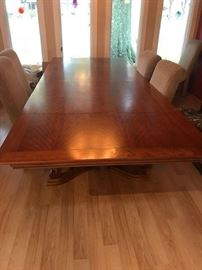 Beautiful DR table with 2 removable leafs on ends.  Top looks very mid-century with base a little more traditional.