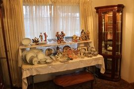 A picture of one of the smaller display cases and beautiful collectibles.