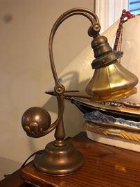 Tiffany lamp with Tiffany shade.