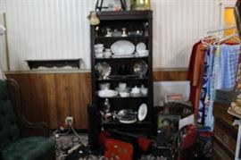 Wood cabinet with glass shelves, assorted silver, milk glass and other items.