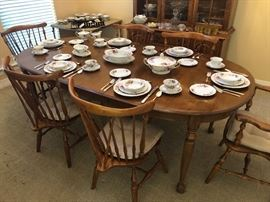 Noritake Gardena Bone China 12 five  piece place setting  in total and other assorted pieces of same pattern place on top of a American Colonial Revival Style dinning table set
