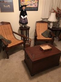 Antique Plantation Chairs with a well conditioned vintage storage chest.