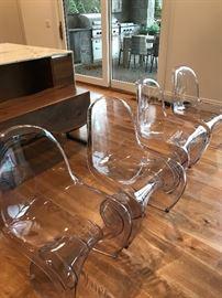 4 acrylic chairs $400