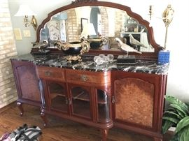 A marble-topped sideboard with all the bells, all the whistles purchased years back at Fortney's Antiques.