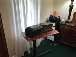 Computer table with antique wooden boxes