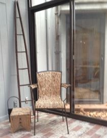 Iron chair with real wood vine seating. Antique apple picking ladder. Foot stool