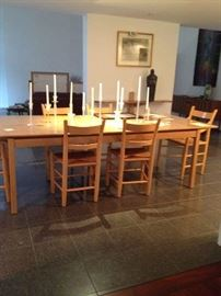 Large solid wood hand made table with hand made cain high back chairs