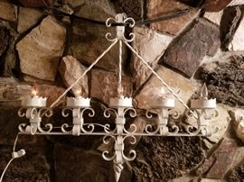 Gothic / Spanish revival wrought iron sconce lamp with flickering candle bulbs