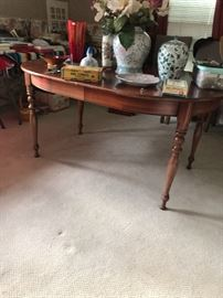 Cherry dining room table that seats 8.  Has 3 leaves
