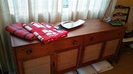 mid century sideboard again with very cool mid cen table covers - stainless serving dishes