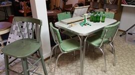 great 1950's formica table with 4 green chairs.  chairs are not perfect but are useable.  vintage Sprite bottles - still full!