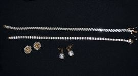 More finds the family wants sold! Two CZ tennis bracelets, CZ earring jackets & CZ earrings.  All are set in 14k gold!