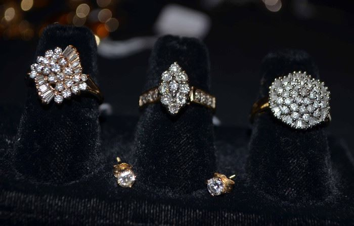 Look what we just uncovered! 14k gold & diamond cluster rings, 1/4 ct each diamond earrings.  The family says SELL!