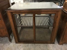 Antique display case with original shelf, possibly for a baker.