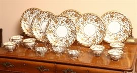Lavishly gold decorated set of china and pierced sterling holders with porcelain inserts by Lenox.