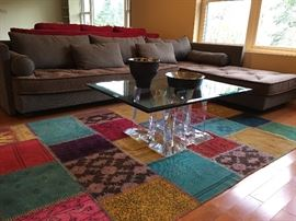 Roche Bobois Sectional, Lucite Coffee Table, Vintage Patch Work Hand Woven Rug, Michael Aram Bowl