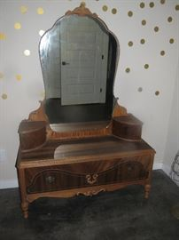 DEPRESSION ERA VANITY AND HAS A MATCHIING ARMOIRE