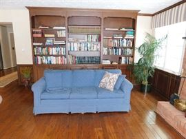 Well made sofa covered by Paul's Upholstery.  Sets of vintage books.