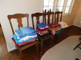 4 Oak chairs. Colorful table linens.