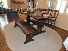 Nice oval cotton rug. Table, bench and chair.
