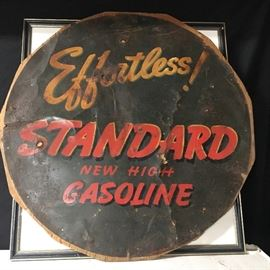 "Very old tin sign, ""Effortless STANDARD New High Gasoline"". Nailed on board."