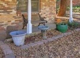 outdoor planters   cast iron bench