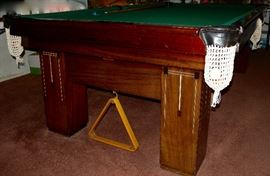 "1924 Monarch Cushion pool table and accessories by The Brunswick-Balke-Collender Co. Table is 56""Wx102""Lx32""H; inside measurements: 48""x93"". Note pearl inlay. Special side drawer for cue sticks. Vinyl cover. Contact 314-518-1818 if interested before the sale."