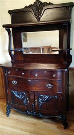 "Antique Sideboard from Signal Mountain with Beveled Mirror and lower cabinets for ease of storing fine linens, drawers for fine silver and top for showcasing those precious heirlooms. Dimensions 76""H x 51"" W x 19' D. Beautiful Piece."