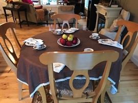 Sturdy, light wood dining table with leaf and 4 chairs