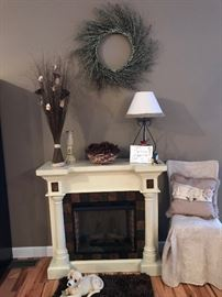 Instant ambiance for the holidays! Electric fireplace with a mantel for your stockings!