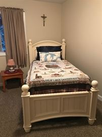 Nice, twin chunky white wood twin bed with trundle.