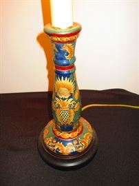 Detail of a hand-painted candlestick lamp
