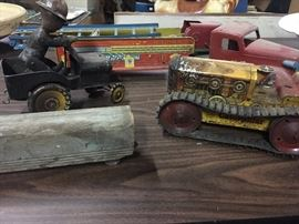 Caterpillar metal toy, fire engine, wind up army man and wood train pieces