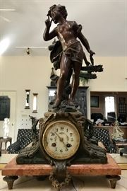 Stunning bronze clock; marble base, made in France, porcelain face on clock; Works beautifully! Has original key
