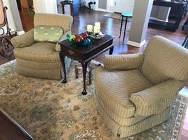 Area rug, upholstered chairs