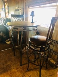 Pub table with iron base and iron barstools