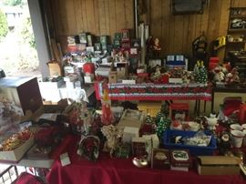 entire garage full of  decorations, mostly Christmas. Boxes of Christmas village with lights many in original boxes, figures and pieces that go with the houses.  Each has lights that fit inside the porcelain houses.