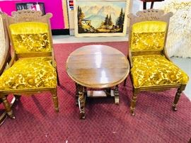 Antique Pr Eastlake Chairs with porcelain wheels. Solid Oak drop leaf oval table